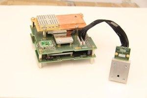 Detekční zařízení s ovládací elektronikou: modul protonového teleskopu na bázi čipu X-CHIP-03 a modul SpacePix. V horní části je umístěn PIN-diodový open source dozimetr Spacedos01.