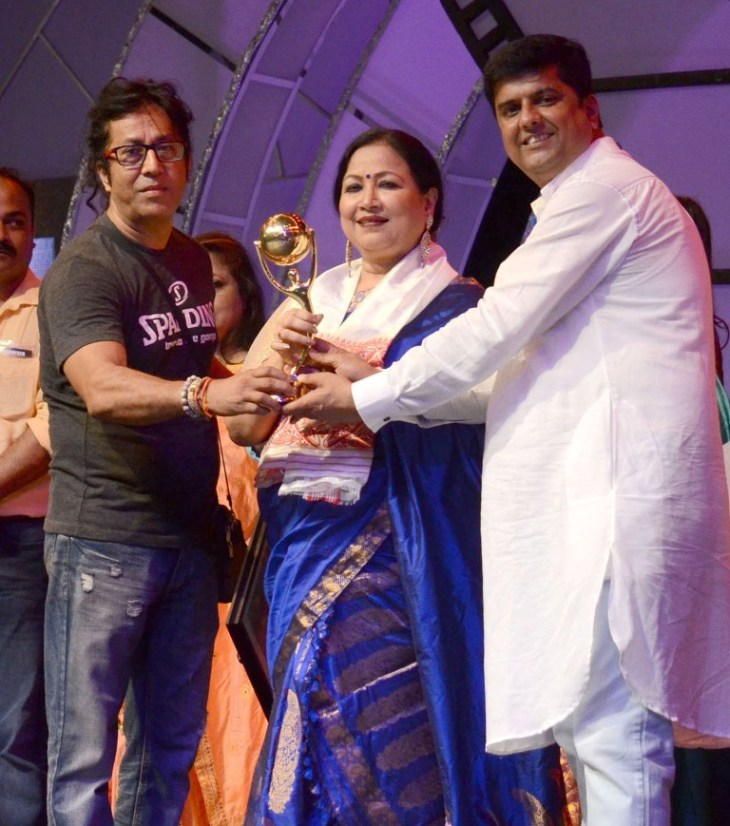 "Noted Assamese  actress Bidya Rao receving ""Prag Cine award"" Life Time Achievement 2016 at Nehru Maiden Tezpur on 15-05-16 night.pix by ub photos"