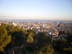 Panoramic view of the city from the top of Tibidabo hill. The temple of Sagrada Familia is right in the center, on the left Torre Agbar and on the right the Twin Towers in Port Olímpic.