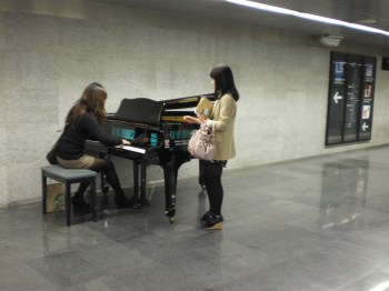 Asian women playing the piano in Diagonal metro station. No, they were not street/metro artists and the instrument was not theirs. Just a kind of advertisement (of a conservatory perhaps?) and these 2 tourists simply took the chance to practice!