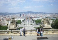 This is the view that you get from the MNAC entrance (Museu Nacional d'Art de Catalunya). The Font màgica is right in front of you, right after you have the famous Venetian Towers of Plaça d'Espanya and at the far end lies the Torre de Collserola and of course Tibidabo hill right next to it.