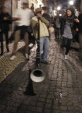 The piper's calling you to join for a drink at a Bairro Alto bar!