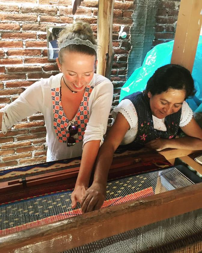 Pastora trying to teach me how to work a loom