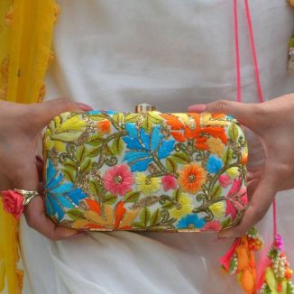 With dress with a colourful clutch