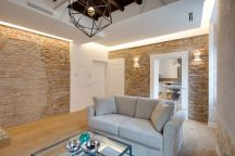 Via-Sistina-Apartment-stone-walls-in-living-room