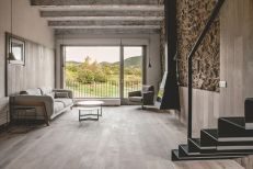 Rustic-house-gets-rehabilitated-in-Spain-living-room-stone-wall