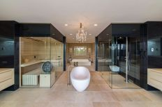 Villa-New-Water-by-Waterstudio.NL-bathroom-tub-at-center