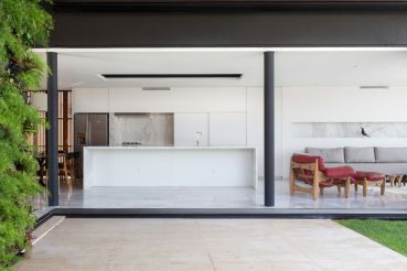 Enseada-House-in-Brazil-kitchen-connected-to-terrace