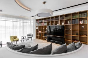 Curving-sofa-and-shelving-entertainment-unit