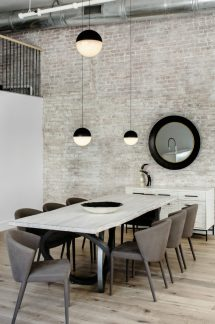 An-open-plan-includes-a-living-zone-a-seating-area-and-a-dining-table-900x1353