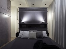Prague-loft-apartment-with-dark-color-palette-in-the-bedroom