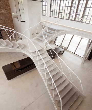 Reinvented-loft-in-Austria-turns-the-staircase-into-a-statement-piece