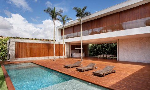 An-House-features-a-large-wooden-deck-by-the-pool