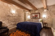 Locanda-La-Gelsomina-stone-walls-in-bedroom