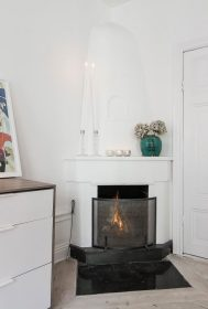 Small-Flat-in-Stockholm-Corner-Fireplace-689x1024