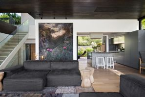 ARRCC-remodeled-residence-is-decorated-with-custom-artwork-that-softens-the-colors