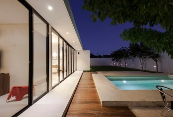 Merida-residence-has-a-beautiful-backyard-with-a-lawn-and-pool