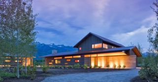 Mountain-facing-house-features-a-wooden-screen-that-shelters-the-outdoor-areas