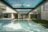 two-pools-atop-one-another-forest-retreat-home