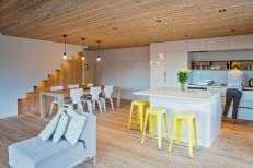 White-kitchen-island-design-Inside-the-decor-is-simple-and-palette-of-materials-used-is-simple-and-dominated-by-wood