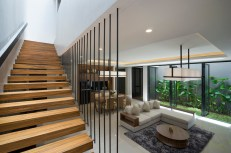 S-House-features-minimalist-wooden-stairs-in-the-living-area