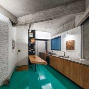 Small-apartment-renovation-features-an-open-kitchen-with-a-long-counter