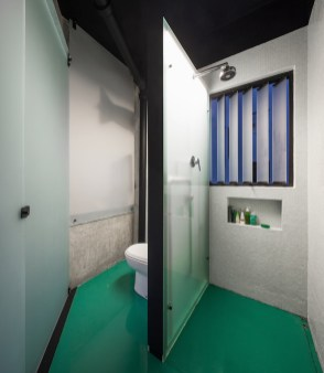 Small-apartment-renovation-replaces-bathroom-partitions-with-glass-panels
