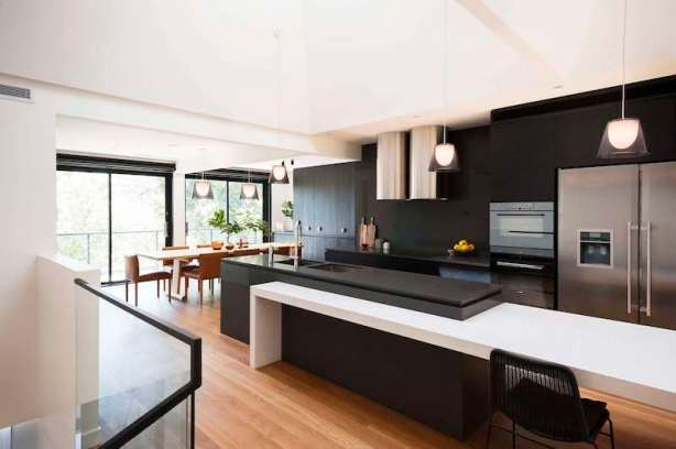 Upside-Down-House-features-a-large-kitchen-with-black-furniture