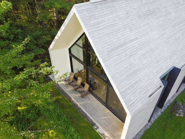 Window-on-the-Lake-cottage-clad-in-wood-inside-and-out