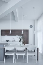 Prague-loft-features-a-corian-and-wood-dining-table