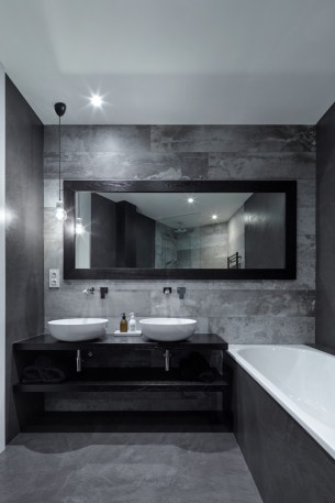 Prague-loft-features-a-dark-bathroom-decor