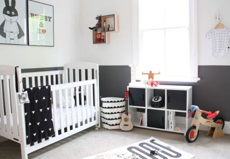 Black-and-white-nursery-room-with-lower-bookshelf-storage