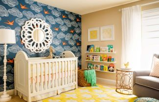 Colorful-nursery-room-with-wood-ledge-for-books