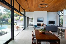San-Mateo-house-features-white-walls-concrete-floors-and-wooden-ceilings