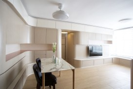 Small-apartment-remodel-in-Hong-Kong-furnished-with-curved-cabinetry