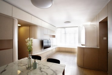Small-apartment-remodel-in-Hong-Kong-has-furniture-with-rounded-edges-and-corners