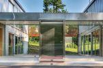 Adam-Kalkin-Shipping-Container-Home-Large-Pivot-steel-door