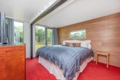 Adam-Kalkin-Shipping-Container-Home-low-ceiling-bedroom