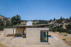 Beautiful-family-retreat-wood-storage-outside-by-Olson-Kundig