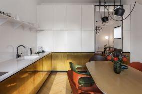 Beautiful-apartment-interior-design-in-Bucharest-by-Bogdan-Ciocodeica-Studio-kitchen-with-brass-lower-cabinets-doors