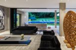 Brazil-Guaica-Residence-Living-room-with-velvet-black-couches