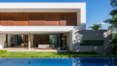 Photo of Modern családi ház a művészet iránti szenvedéllyel