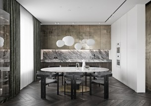 Oval-White-Marble-Dining-Room-Table-In-Kitchen-With-Gold-Cupboards-And-Marble-Counter
