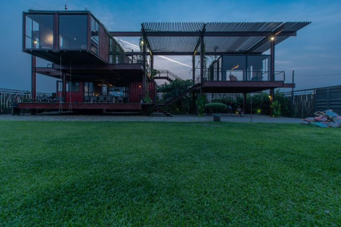 Three-story-residence-from-recycled-shipping-containers-by-night