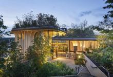 """Photo of A Thomas Heatherwick által tervezett Egészségügyi Központ úgy néz ki mint """"három hatalmas virágláda"""""""