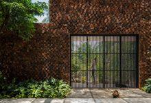 Photo of A CTA Creative Architects perforált téglákból épített házat Vietnámban
