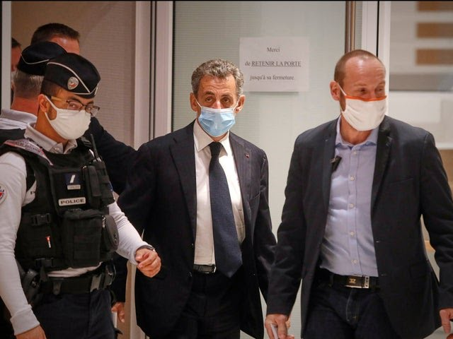 Ex-French President Sarkozy, lawyer in court for corruption