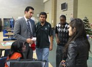 Congressional candidate Ruben Kihuen talks with Hispanic Student Union faculty adviser, Isaac Barron, and students at the club's Holiday party.