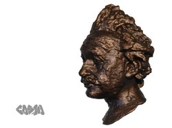 One of Wenman's prints of an Albert Einstein bust. He applied a bronze finish to this one.