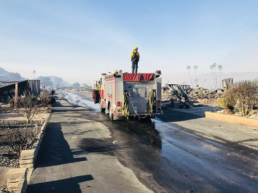 A fire truck passes through a neighborhood burned down by the Lilac Fire at R...